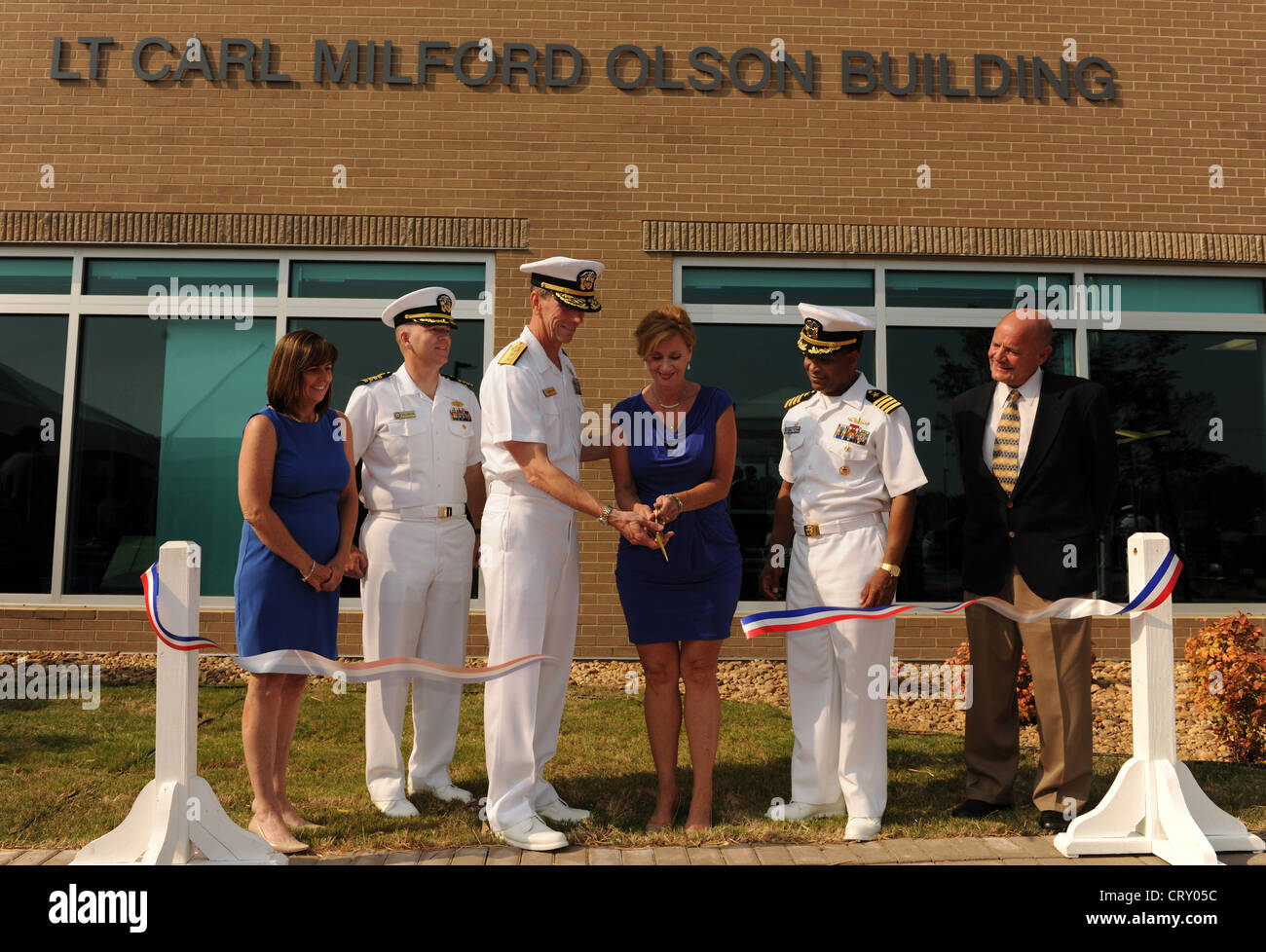 Carol Curtis, president of Noah Enterprises, left, Capt. Paul Odenthal, executive officer of Naval Facilities Engineering - Stock Image
