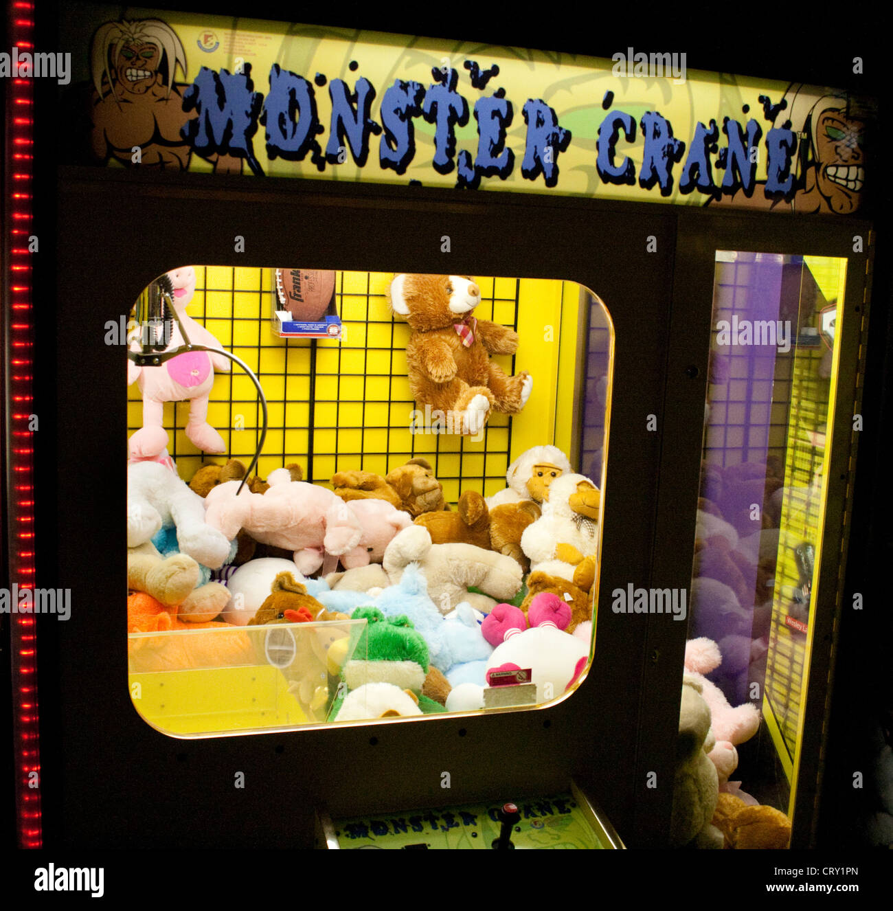 Monster Crane Giant Claw Redemption Machine arcade animal pick up game. Grand Slam Amusement Center Burnsville Minnesota - Stock Image