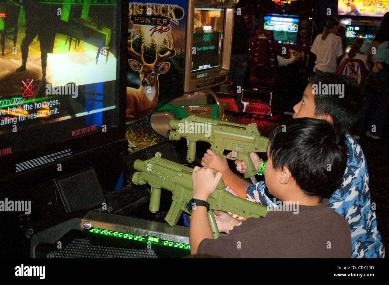 Arcades In Mn >> Asian American Boys Age 7 Playing Arcade Electronic Video Rifle Game