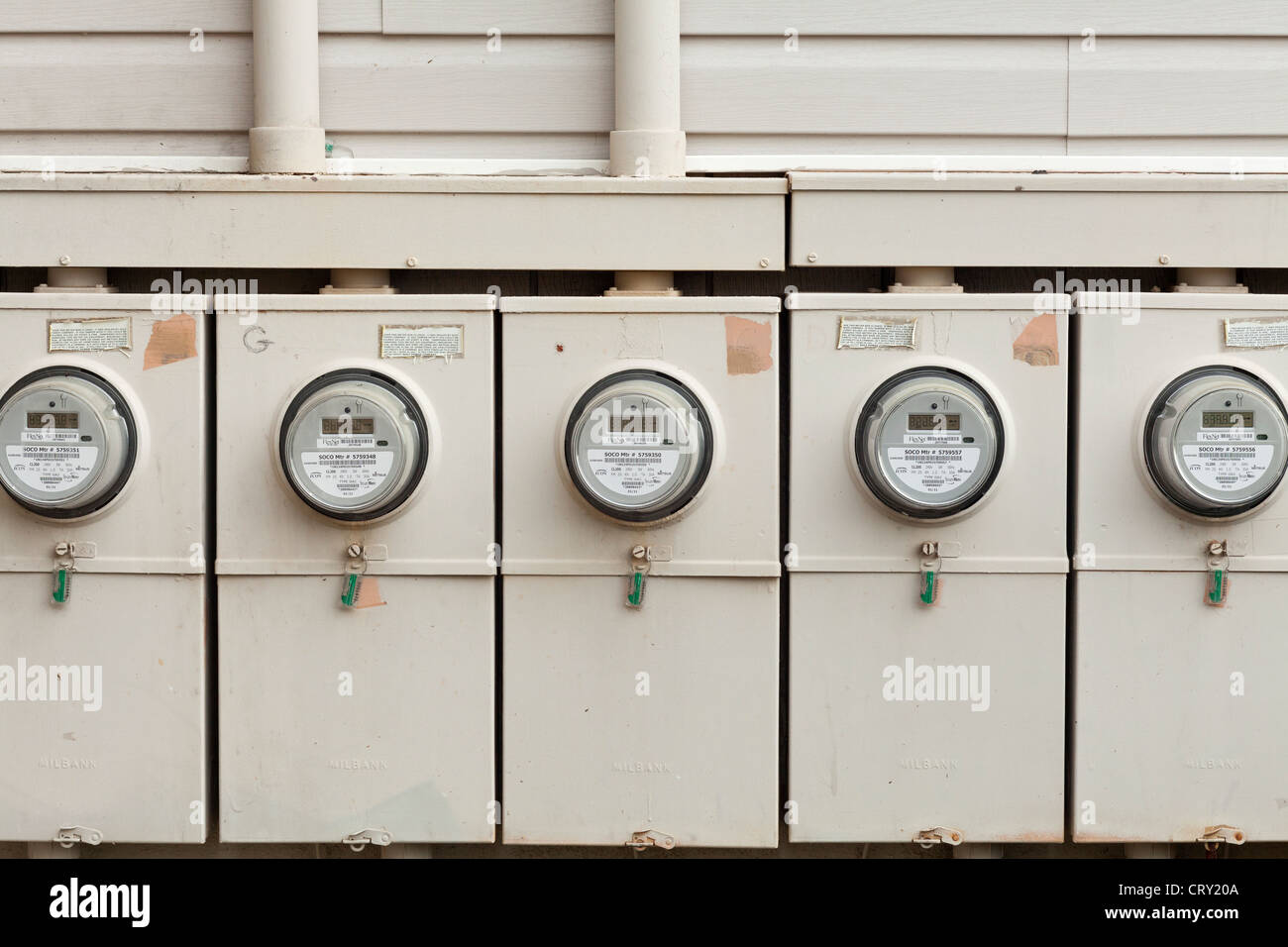Row of Digital Electricity Meters at apartment complex - Stock Image