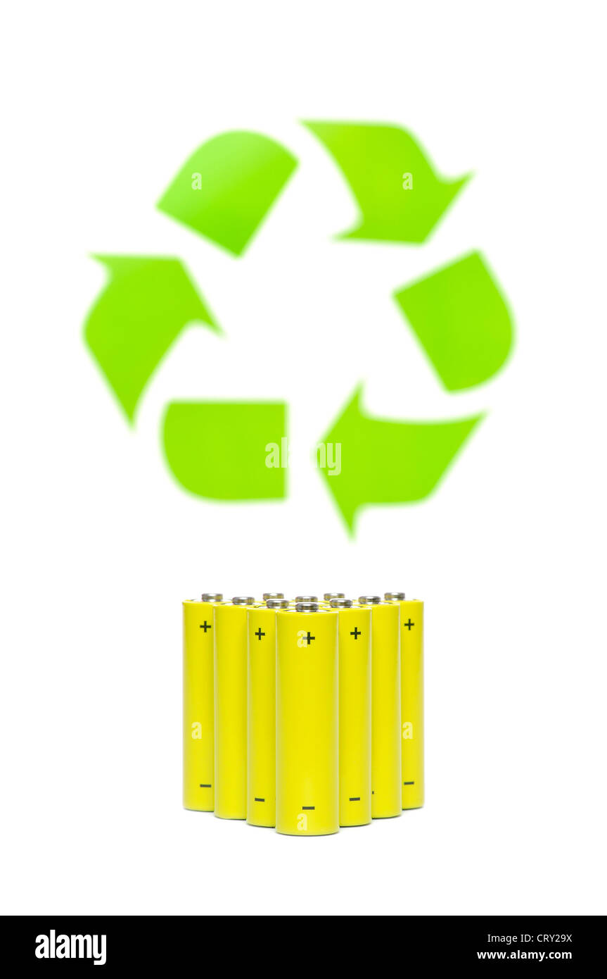 Yellow batteries with recycling symbol on white - Stock Image