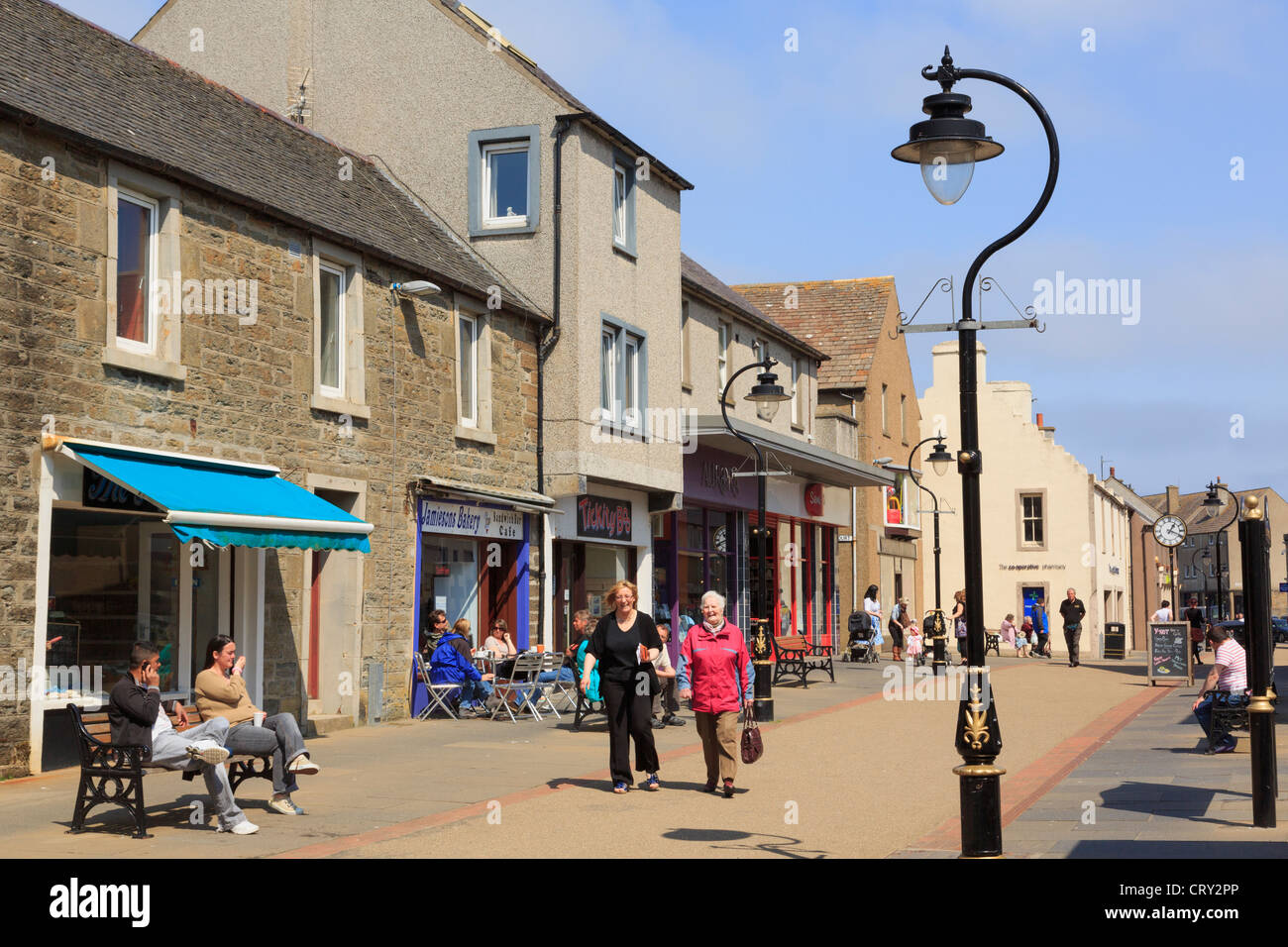 Street scene with small shops and people shopping in the town centre. High Street, Thurso, Caithness, Scotland, - Stock Image