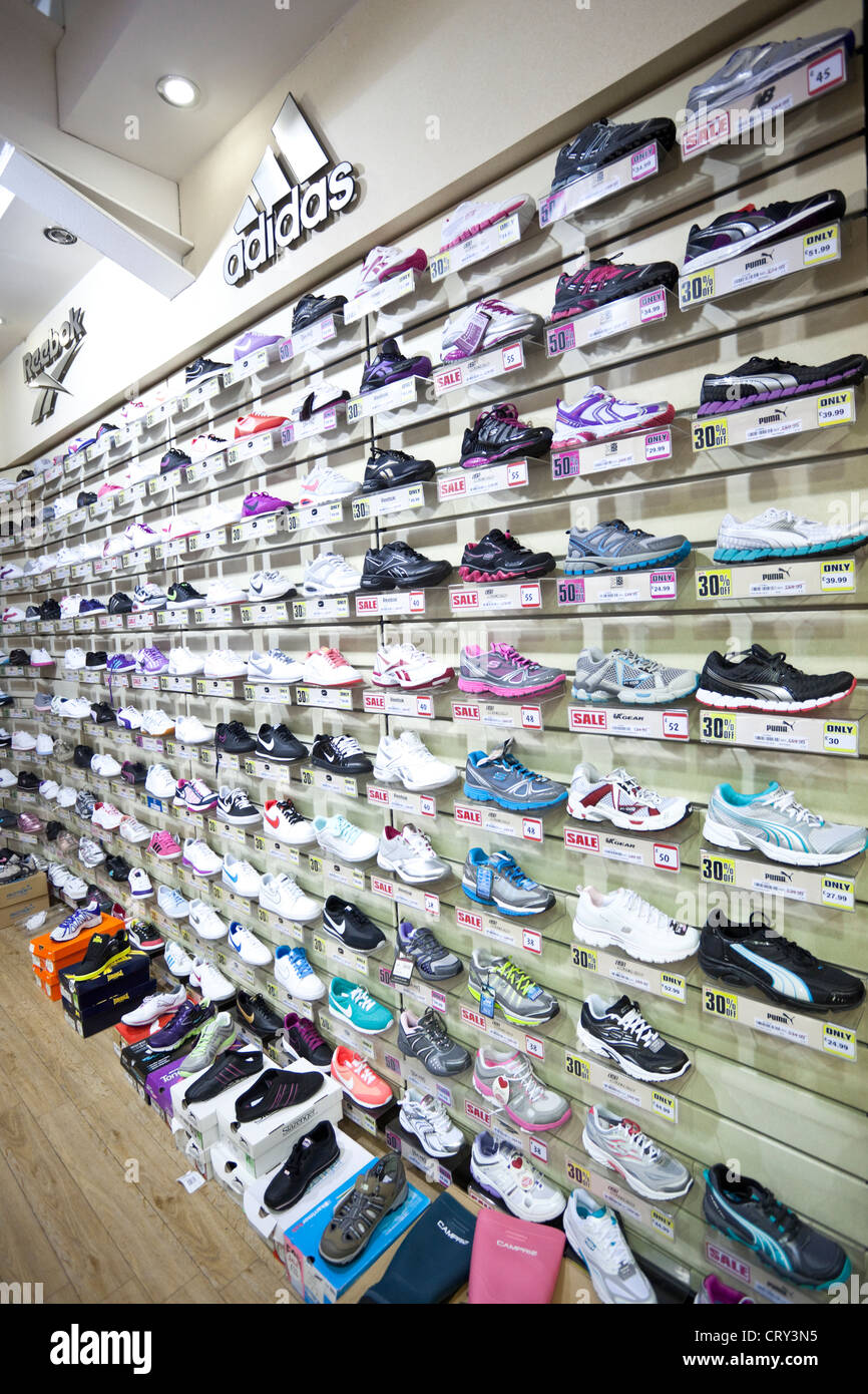 Trainers on display for sale at Sports