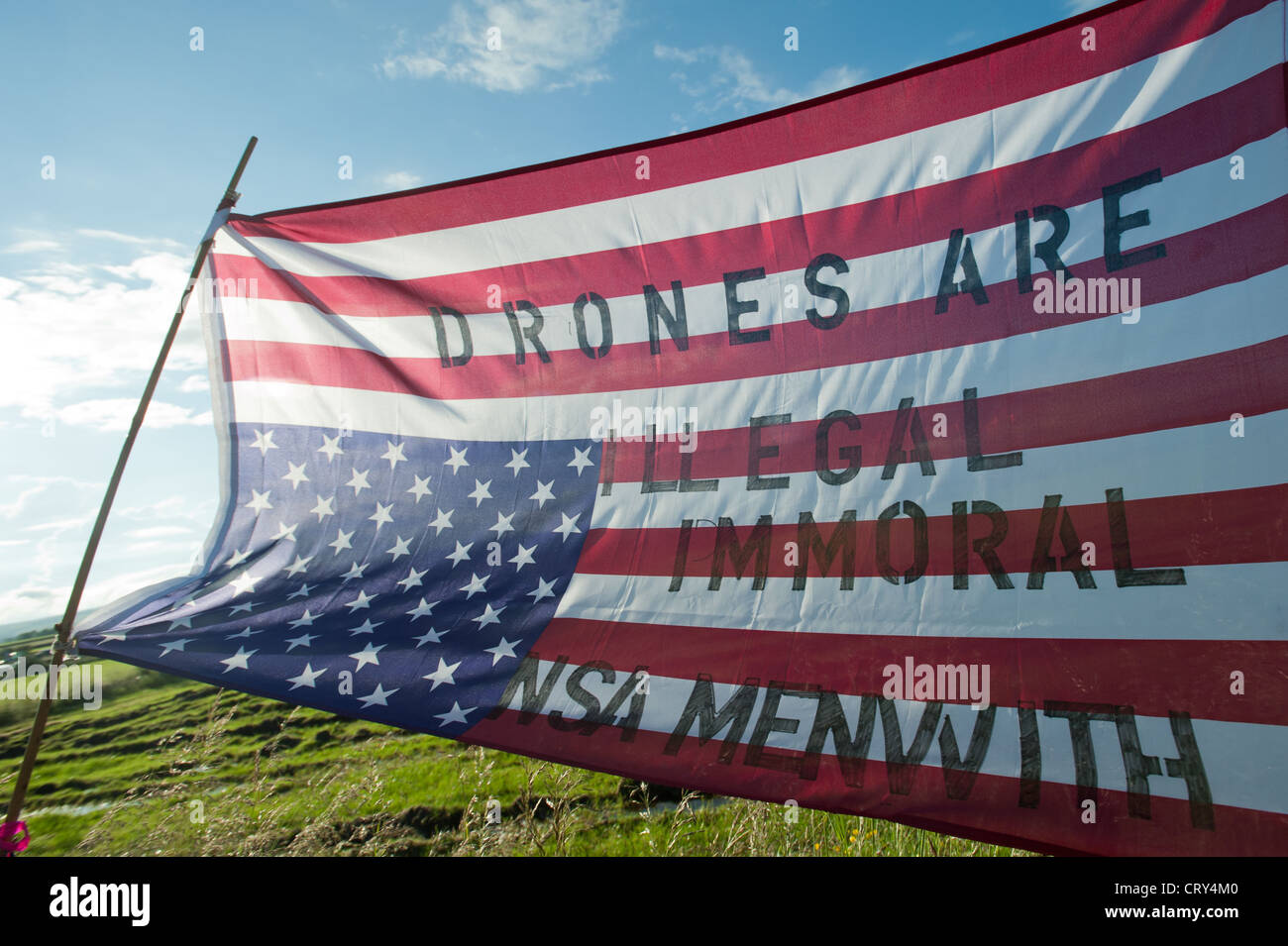 A flag outside menwith hill spy base at the site of the protest by Campaign for accountability of US bases - Stock Image
