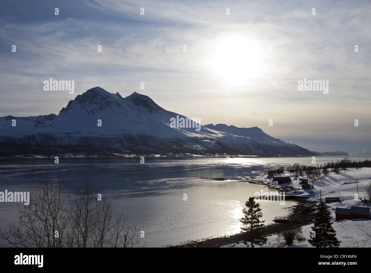 View across Tromso Sound to Tromso and the Lyngen Alps from Kvaloya Island in Arctic Circle Northern Norway Stock Photo