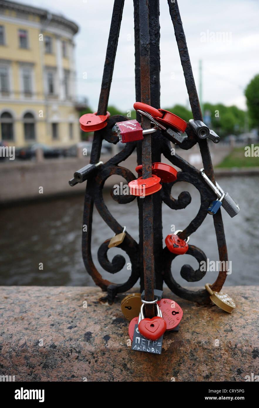 Love padlocks on bridge. St. Petersburg, Russia - Stock Image