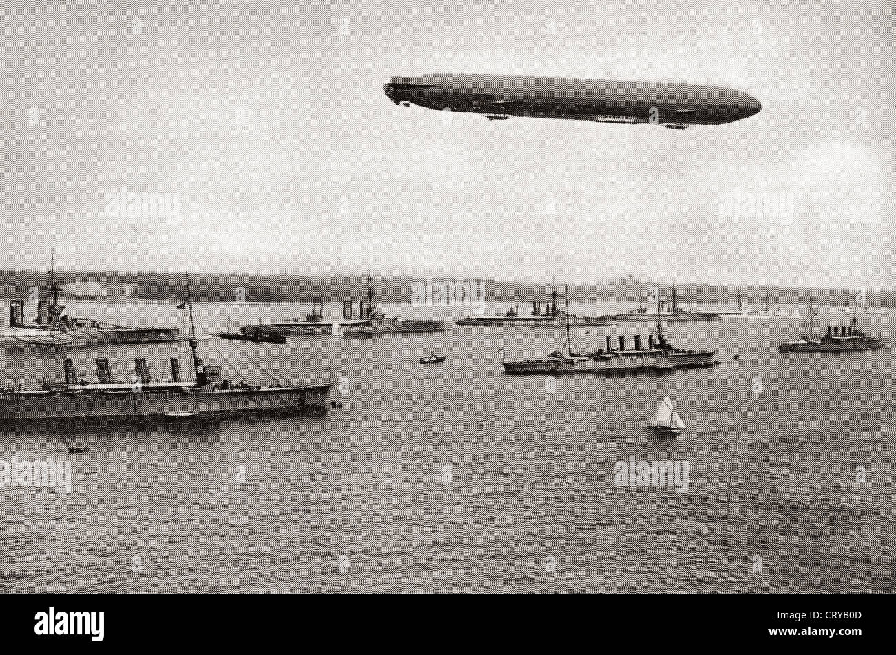 Zeppelin over warships in the Kiel canal, Germany during World War I. From The Year 1914 Illustrated. Stock Photo