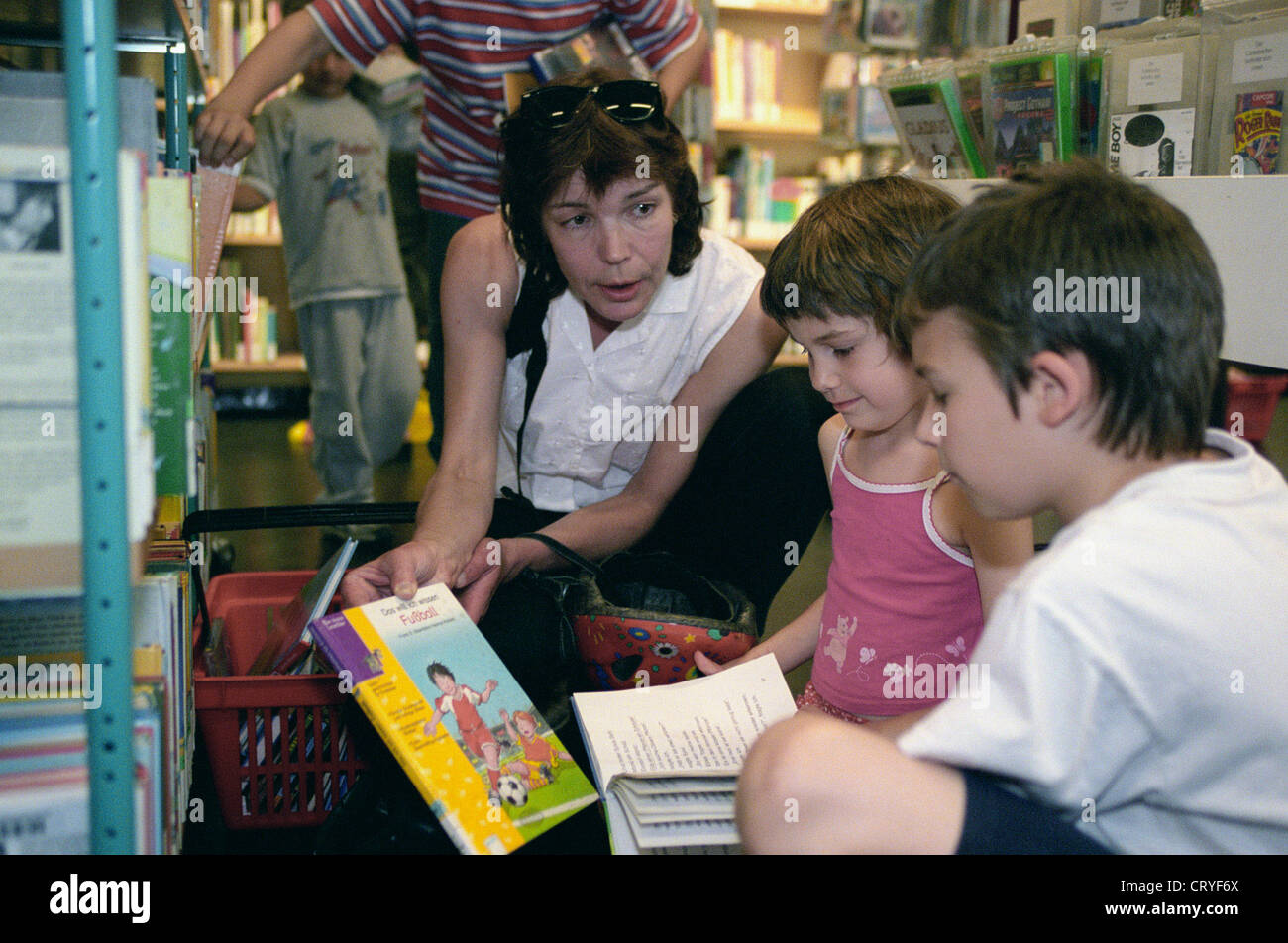 A family in the Children's Library of America Memorial Library (T) Stock Photo