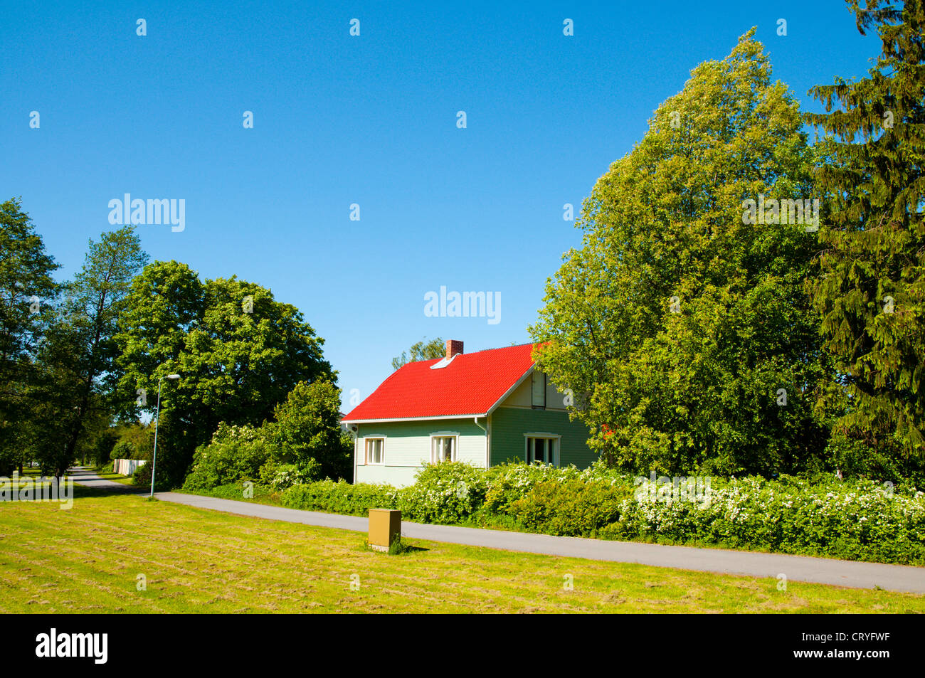 Residential detached wooden house by park in Toejoki district Pori Finland Europe - Stock Image