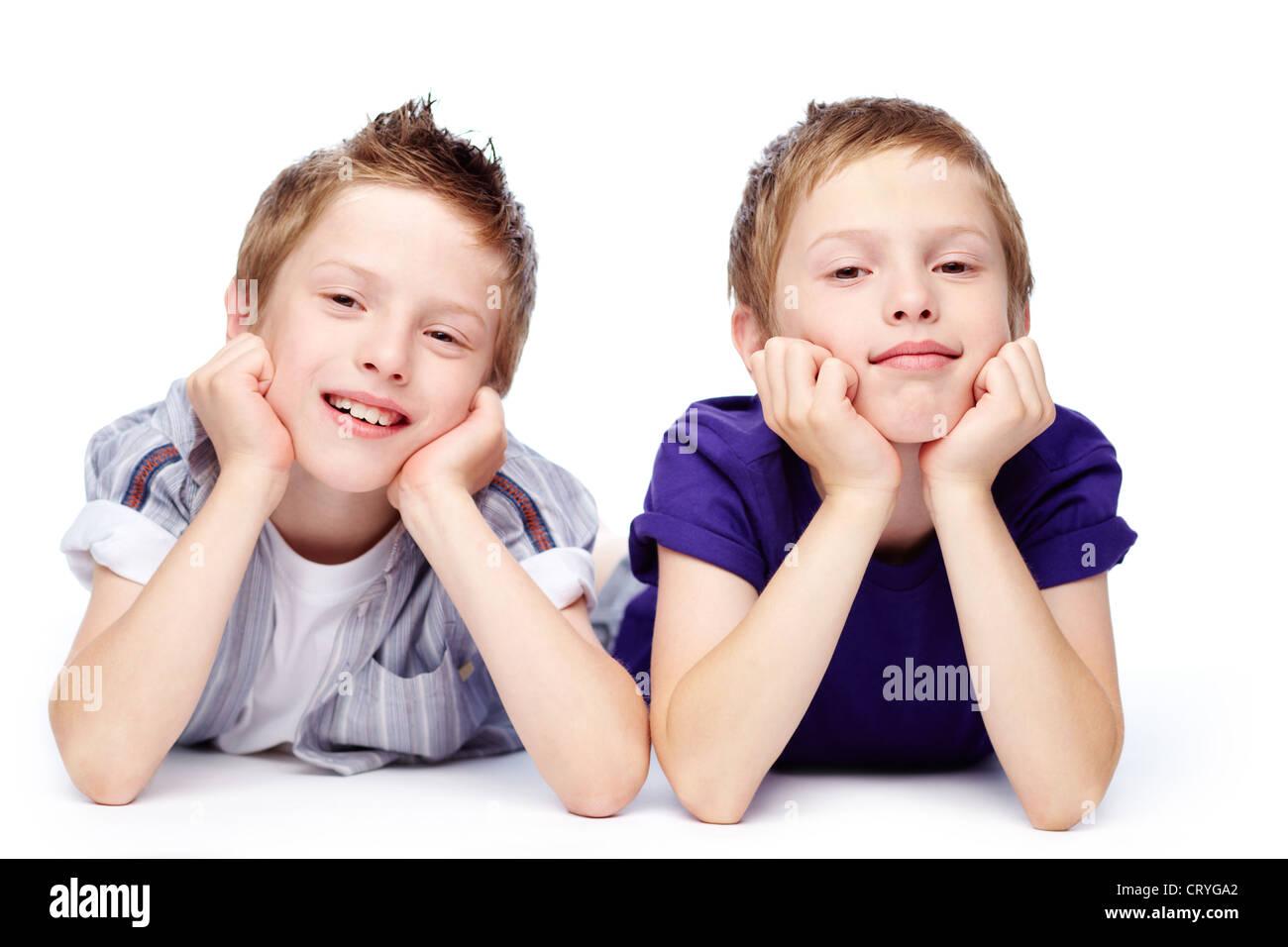 Portrait of cute twins enjoying doing nothing - Stock Image