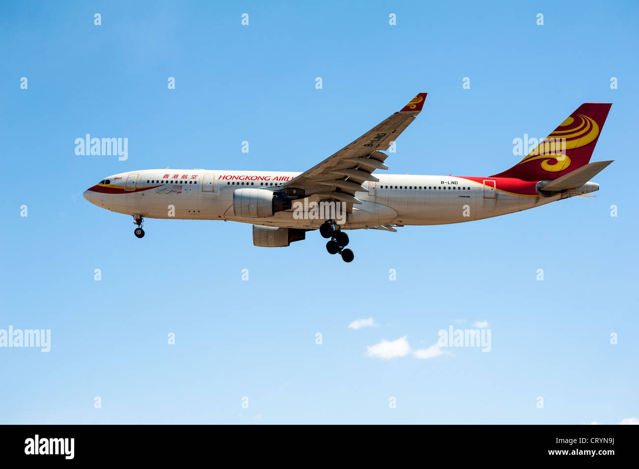 Hongkong Airplane A330-200 is ready to land on the airport - Stock Image