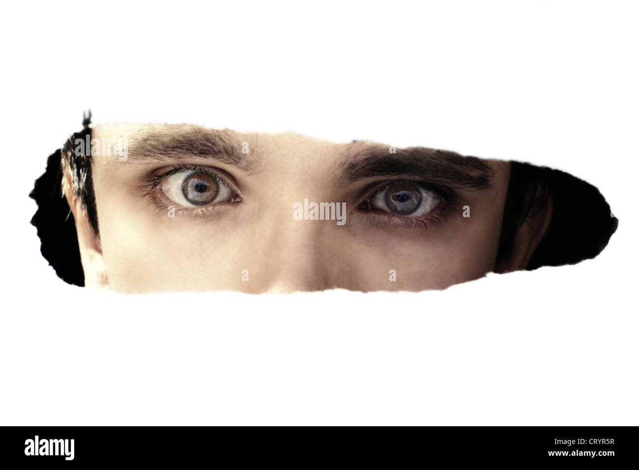 Scary Eyes Of A Man Spying Through Hole