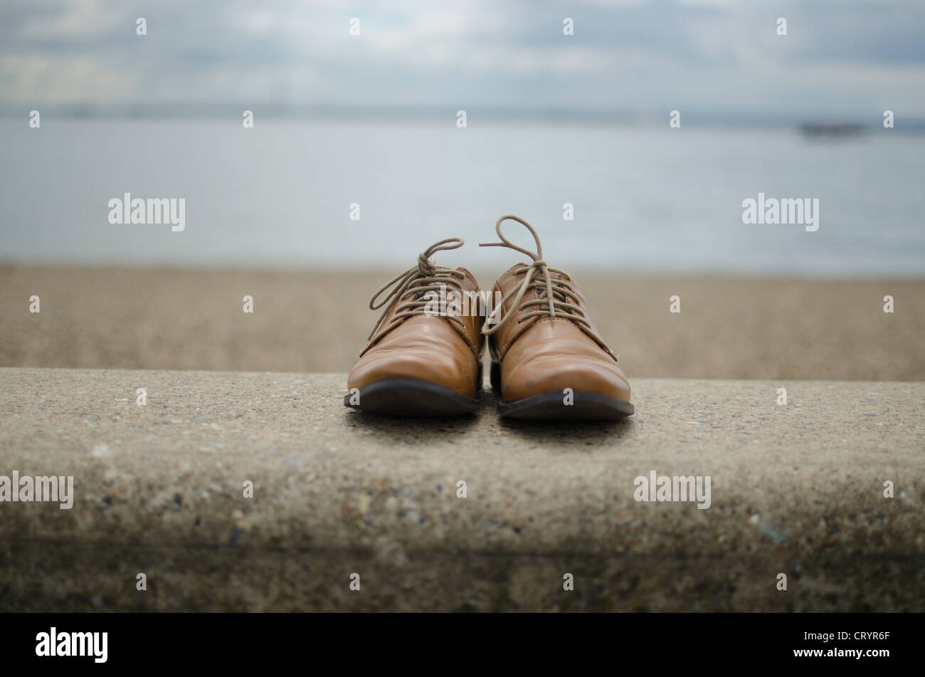 Brown Brogues on the Sea Wall, Southend-On-Sea, Essex, England - Stock Image