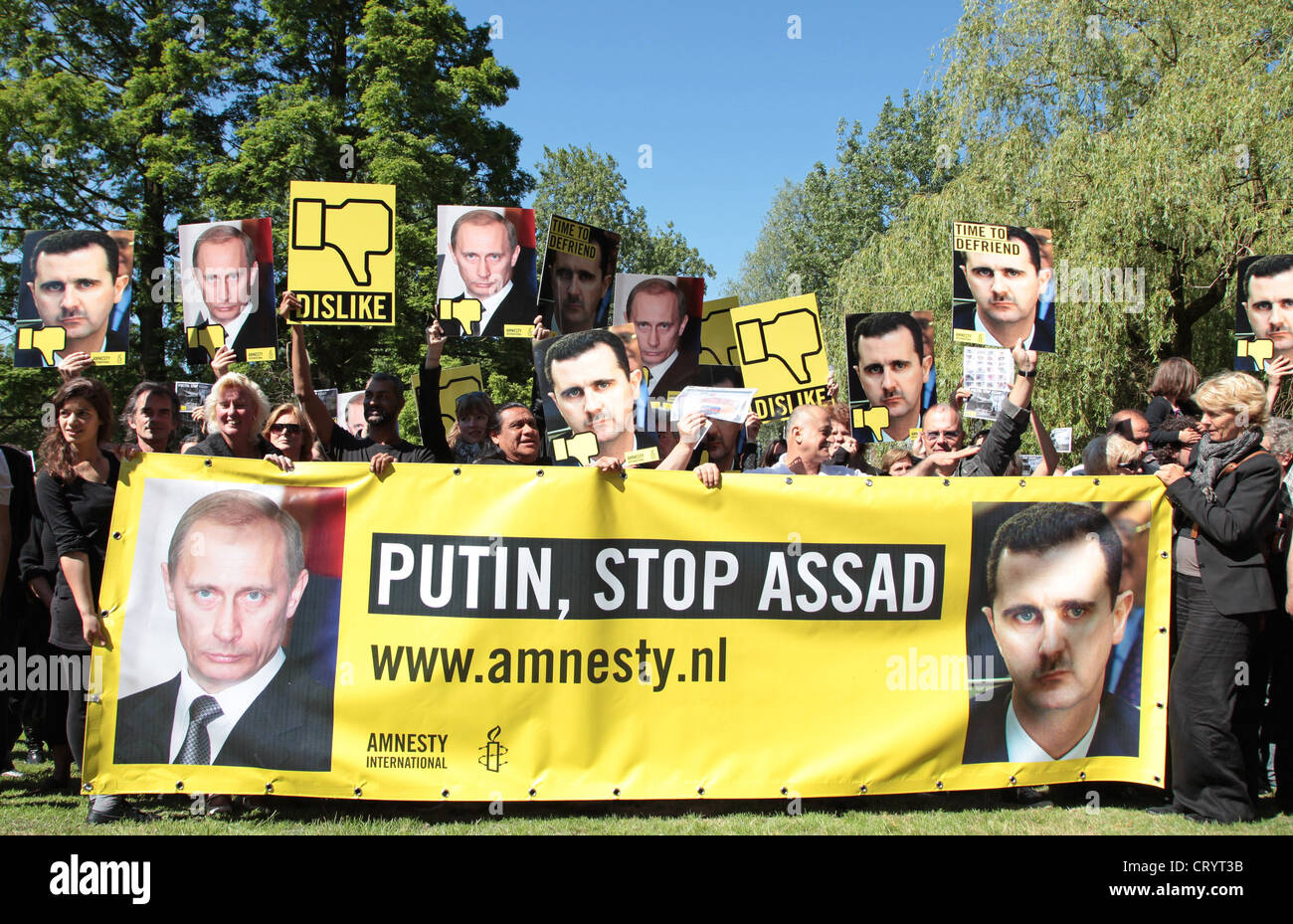People from Amnesty in The Netherlands ask Putin to stop Bashar al-Assad  to use violence against the people of - Stock Image