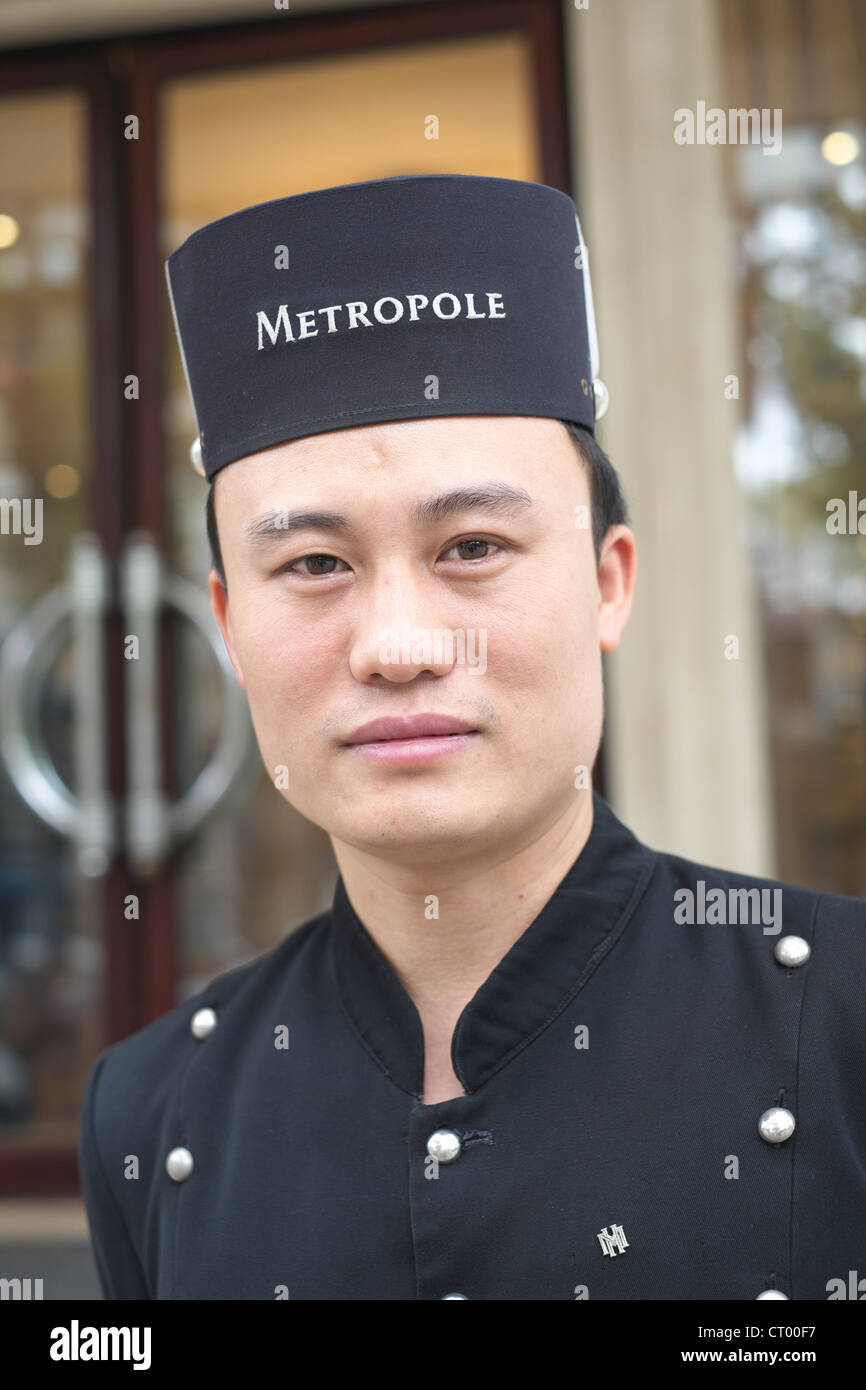 Portrait of doorman at Metropole Hotel in Hanoi Vietnam - Stock Image