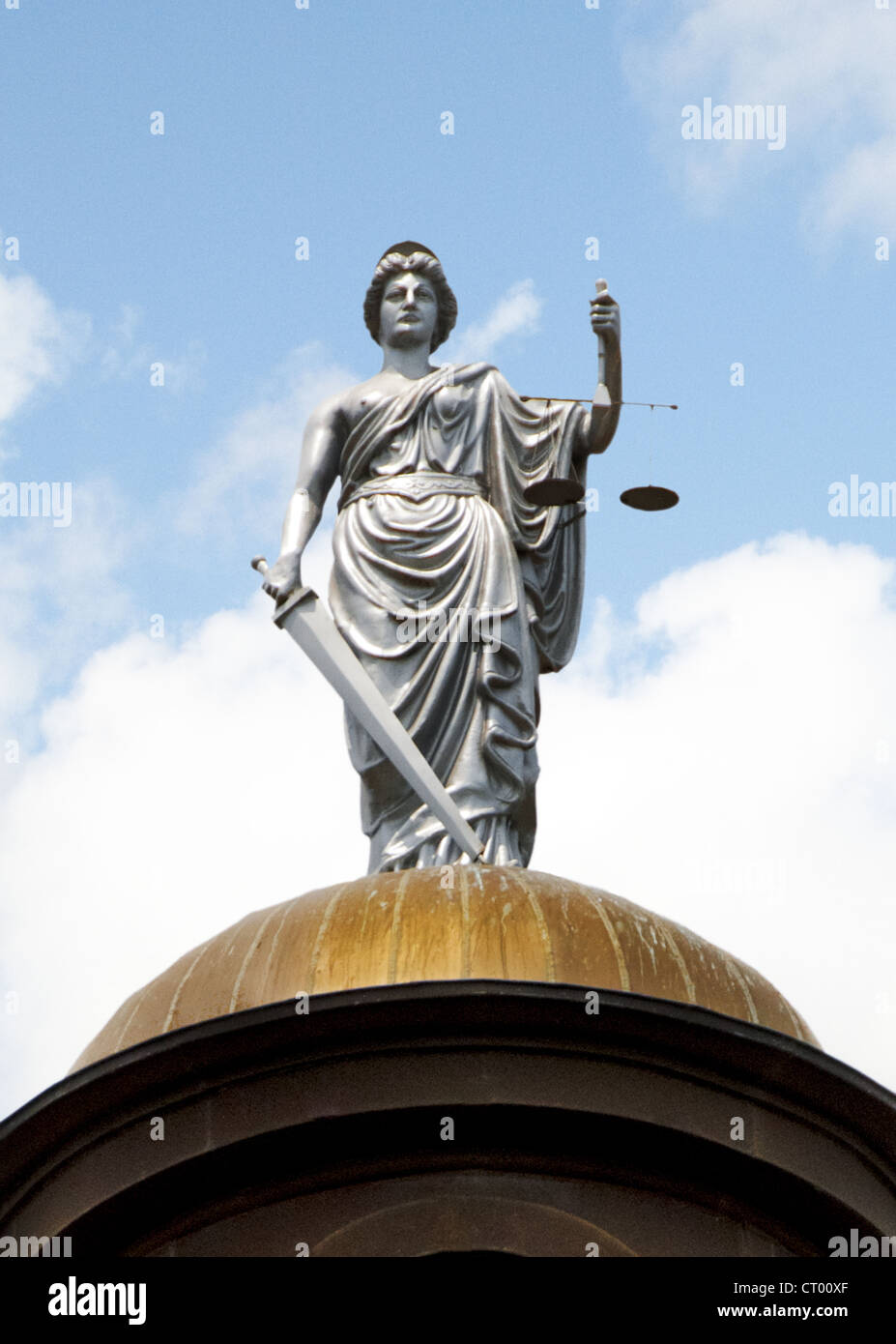 Statue of Justice on top of copper dome of 1908 Hays County Courthouse in San Marcos, Texas, USA - Stock Image