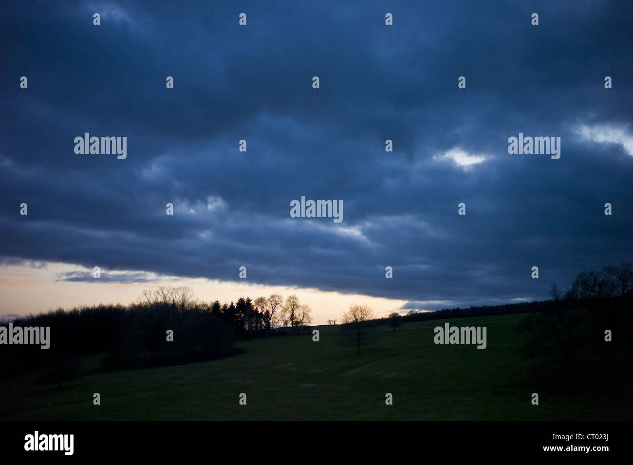 Rainstorm weather front above Swinbrook in the Cotswolds, Oxfordshire, UK - Stock Image