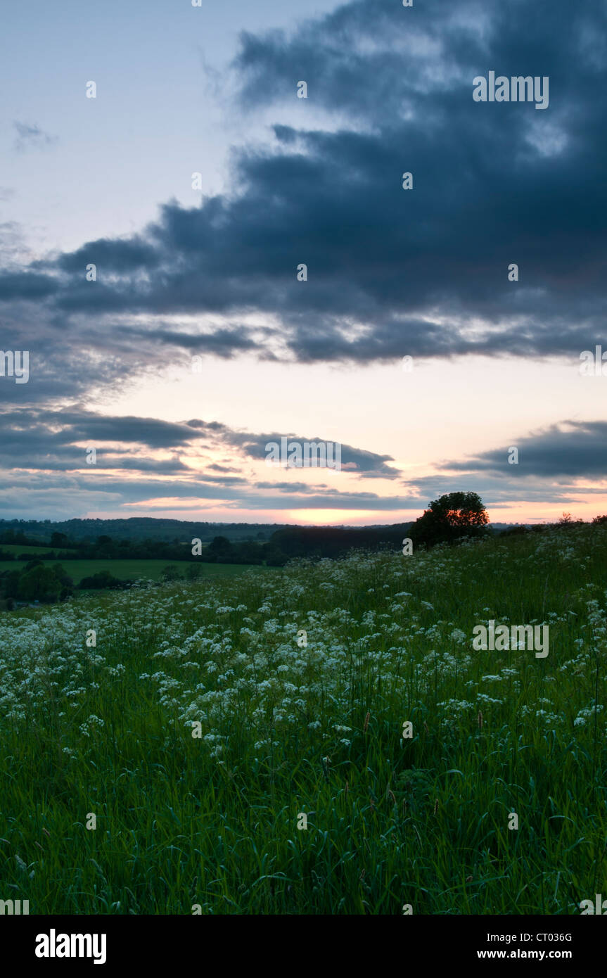 Dark clouds gather above the Brampton valley in Northamptonshire, England, at sunset - Stock Image