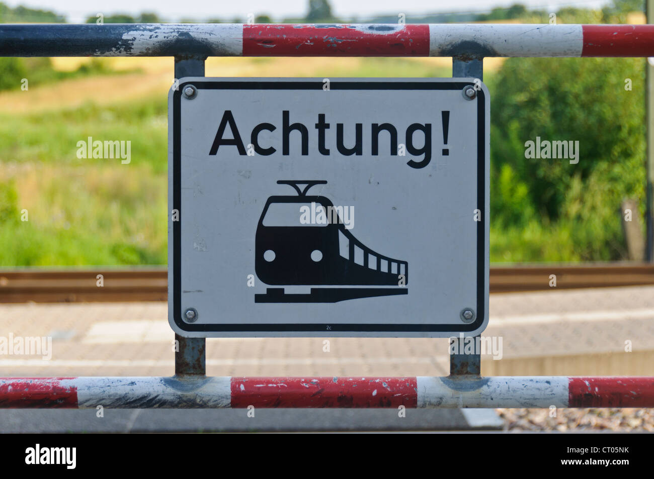 "German Railroad Level Crossing Warning Sign ""Achtung"" Attention Stock Photo"