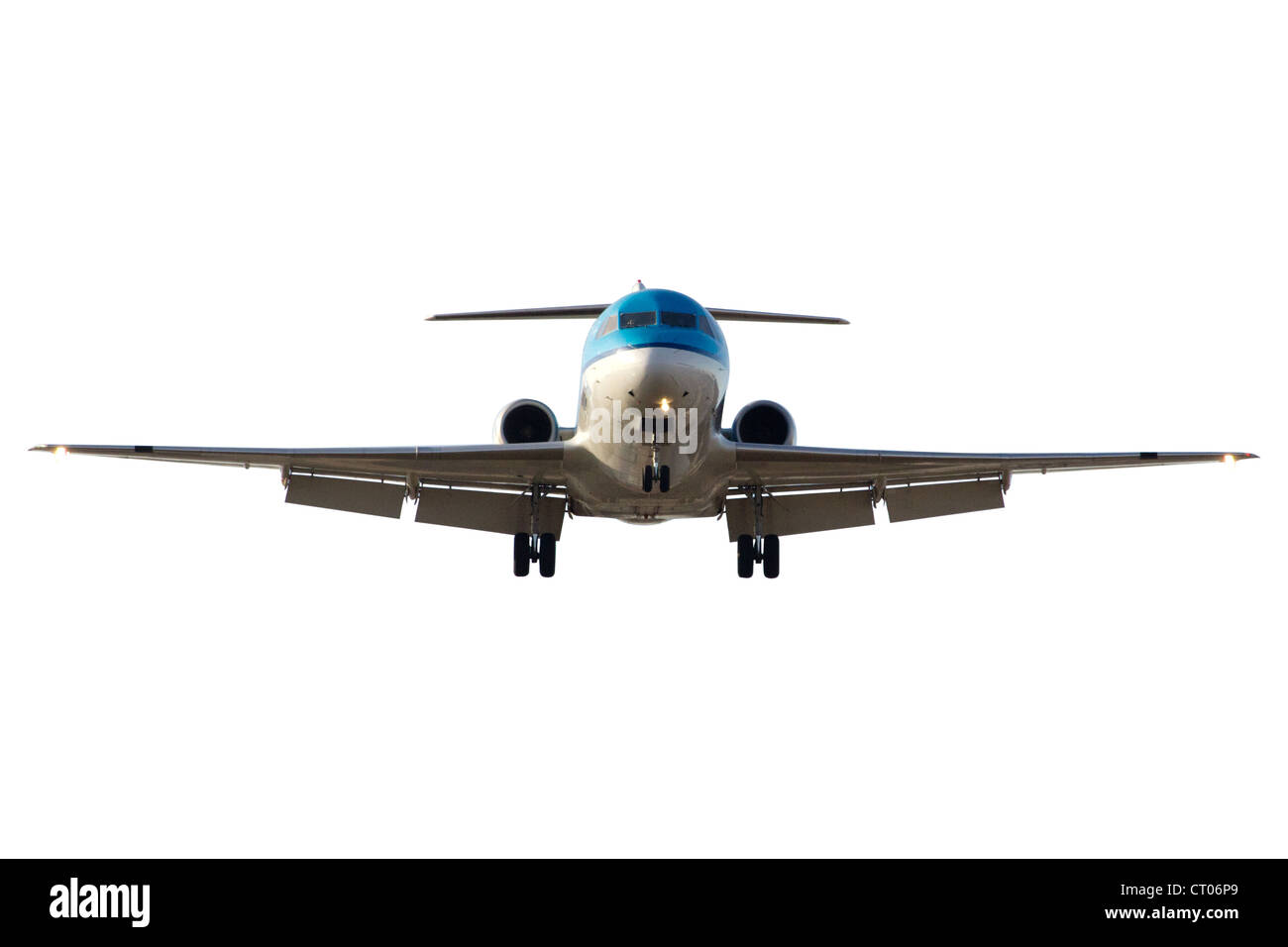 Front view of a landing airliner. Isolated with clipping path - Stock Image