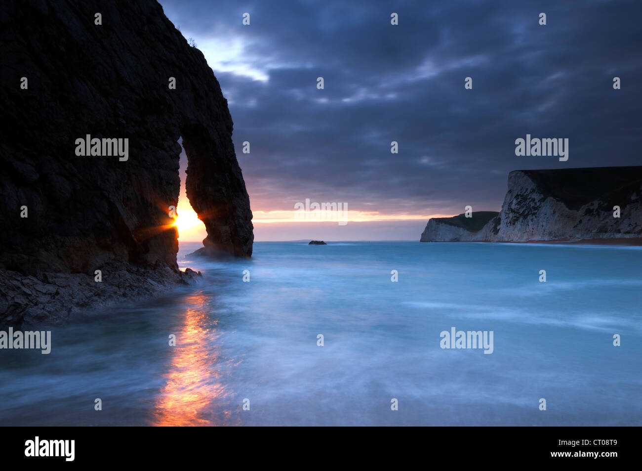 Durdle Door at sunset, Jurassic Coast, Dorset. - Stock Image