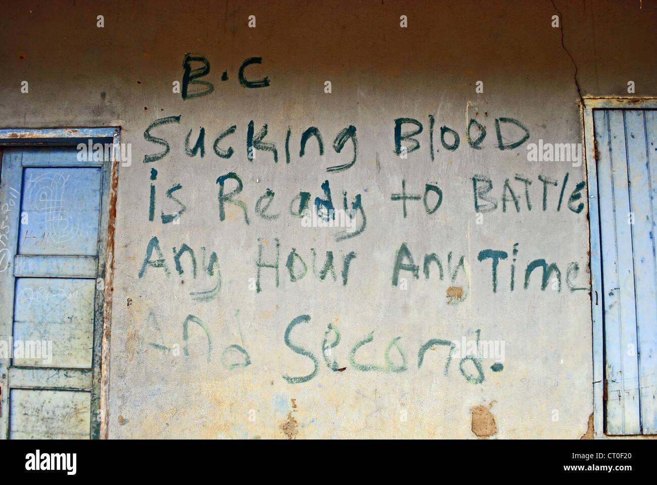 War-graffiti in Bolahun, northern Liberia - Stock Image