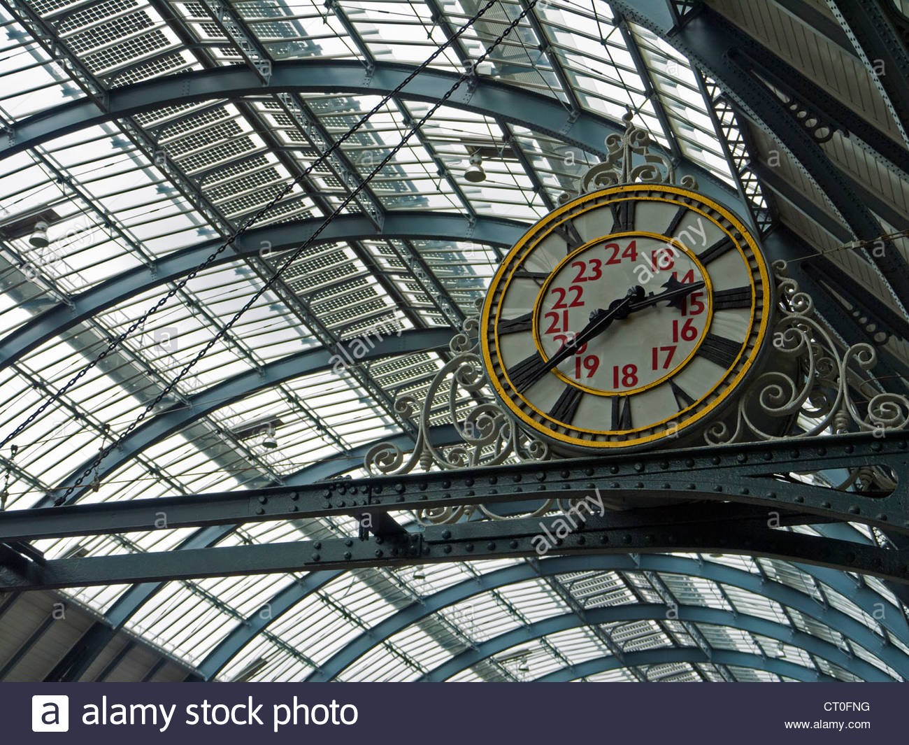 Kings Cross Railway Station old analogue Clock under roof London England UK - Stock Image