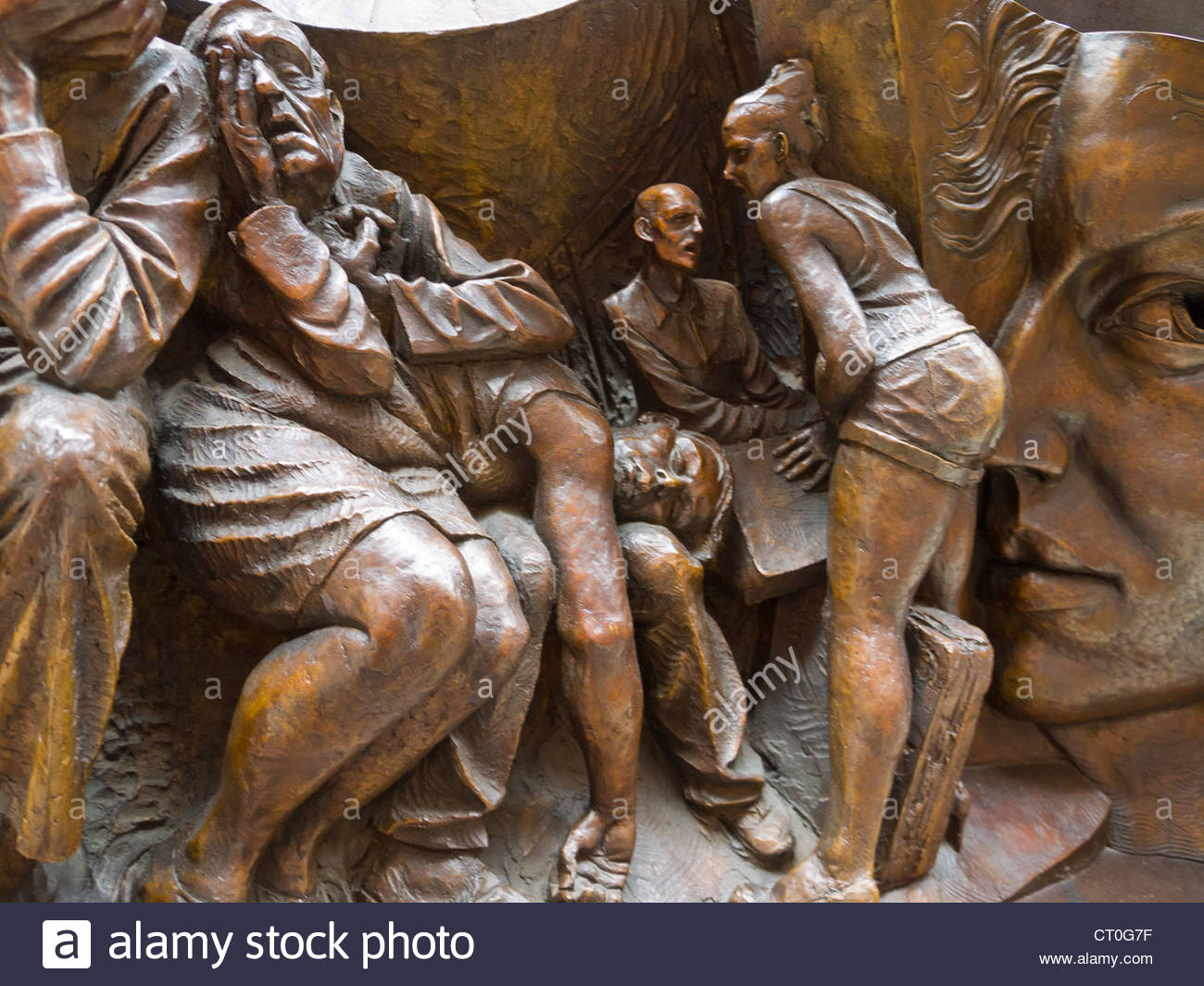 Tired Travellers Part of sculptured frieze of figures by Paul Day St Pancras Station London England Stock Photo