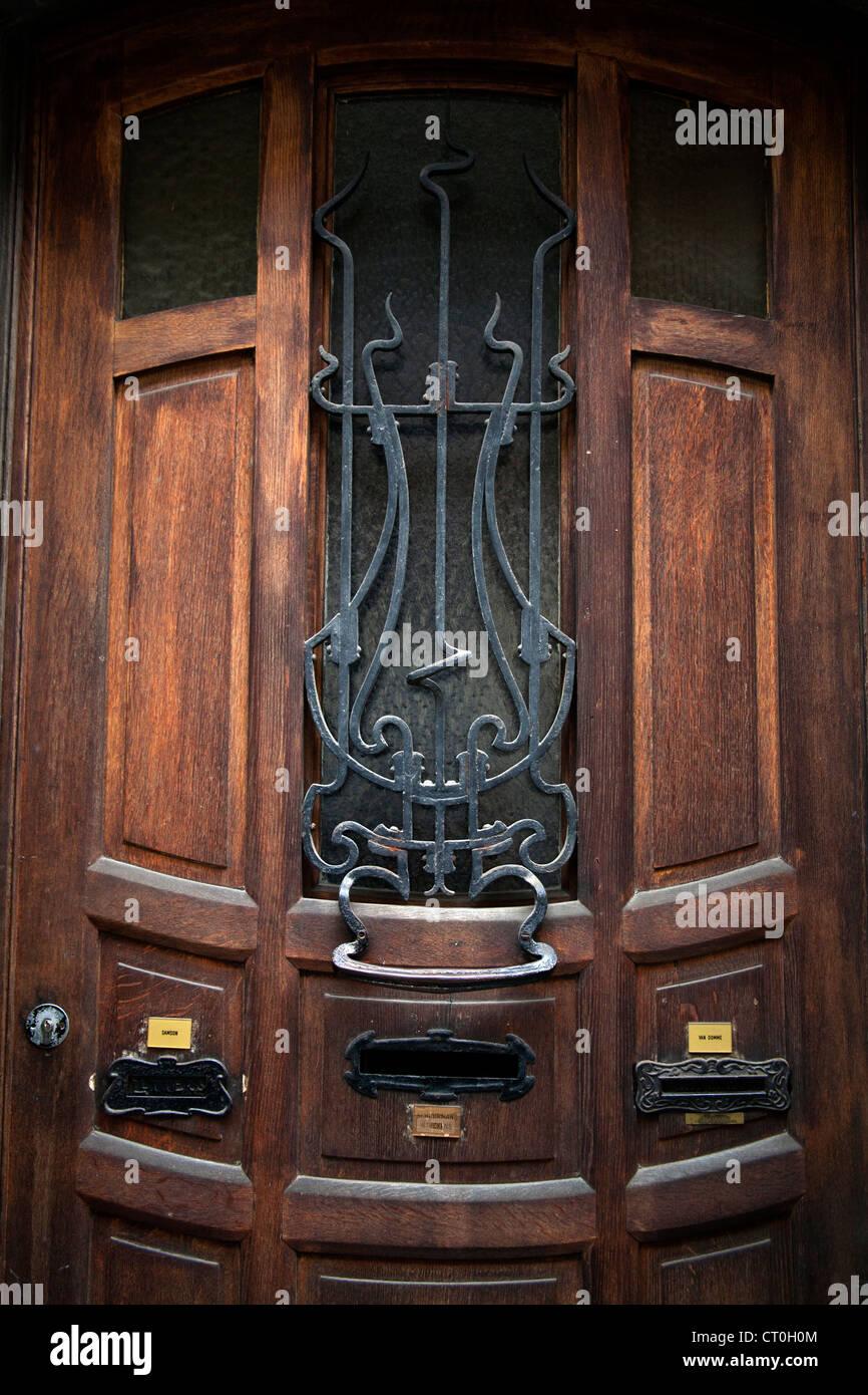 Wooden door with three letterboxes on a Ernest Blerot Art Nouveau house on rue Vanderschrick Saint-Gilles Brussels Belgium & Wooden door with three letterboxes on a Ernest Blerot Art Nouveau ...
