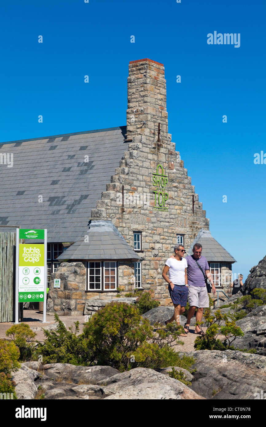 Middle-aged gay couple at Table Mountain cafe, on top of Table Mountain,