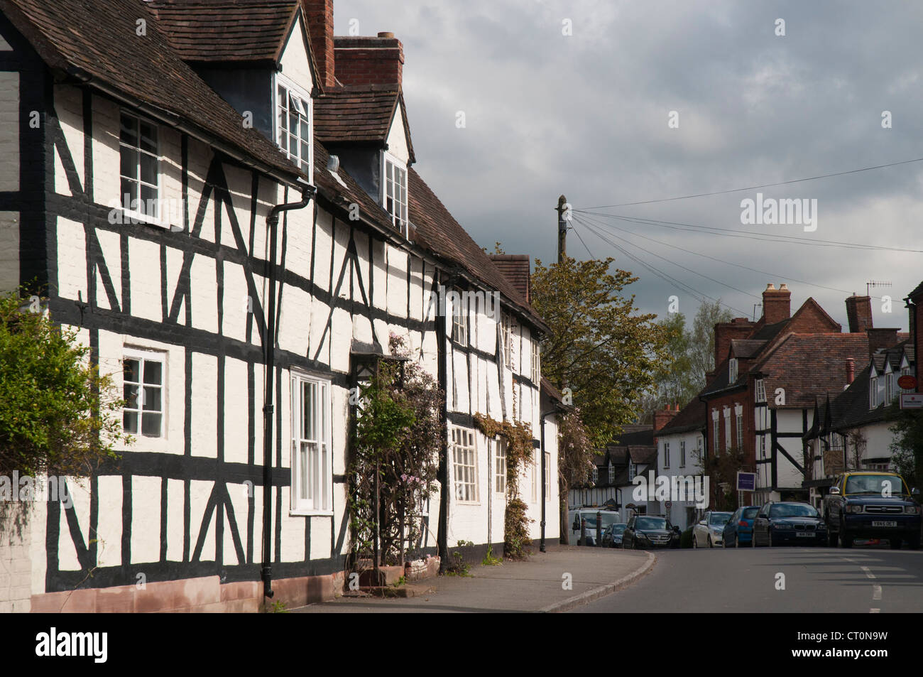High street lined with half-timbered buildings in Chaddesley Corbett in the English Midlands - Stock Image