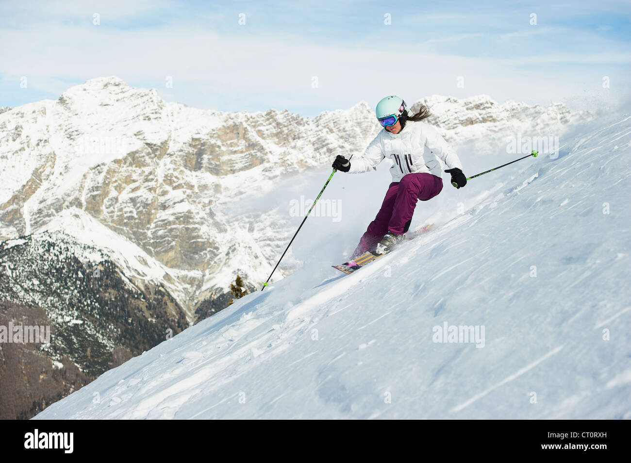 Skier skiing on snowy slope - Stock Image