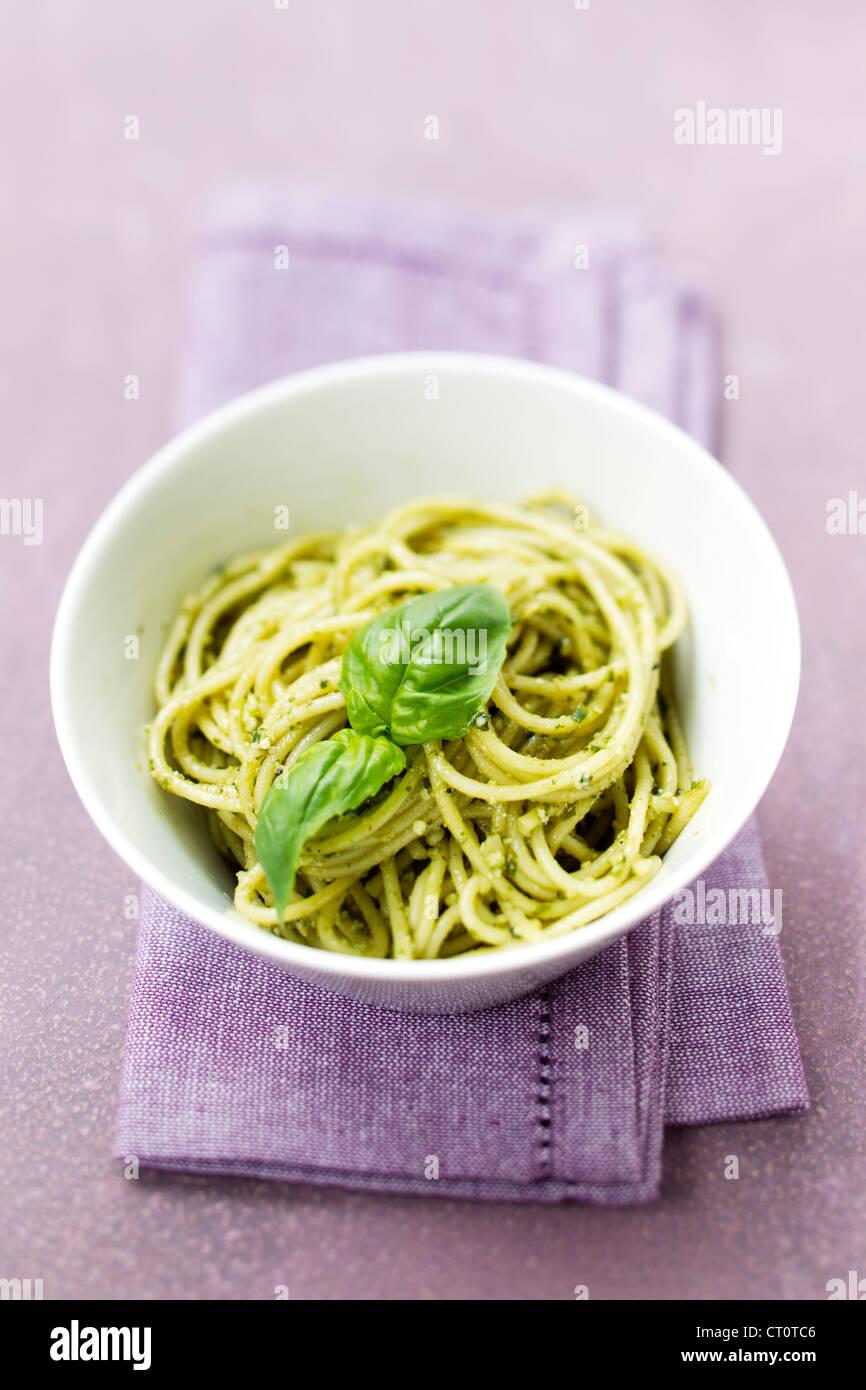 Close up of bowl of pesto pasta - Stock Image