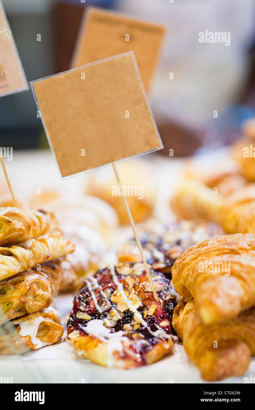 Stacks of fresh pastries for sale - Stock Image