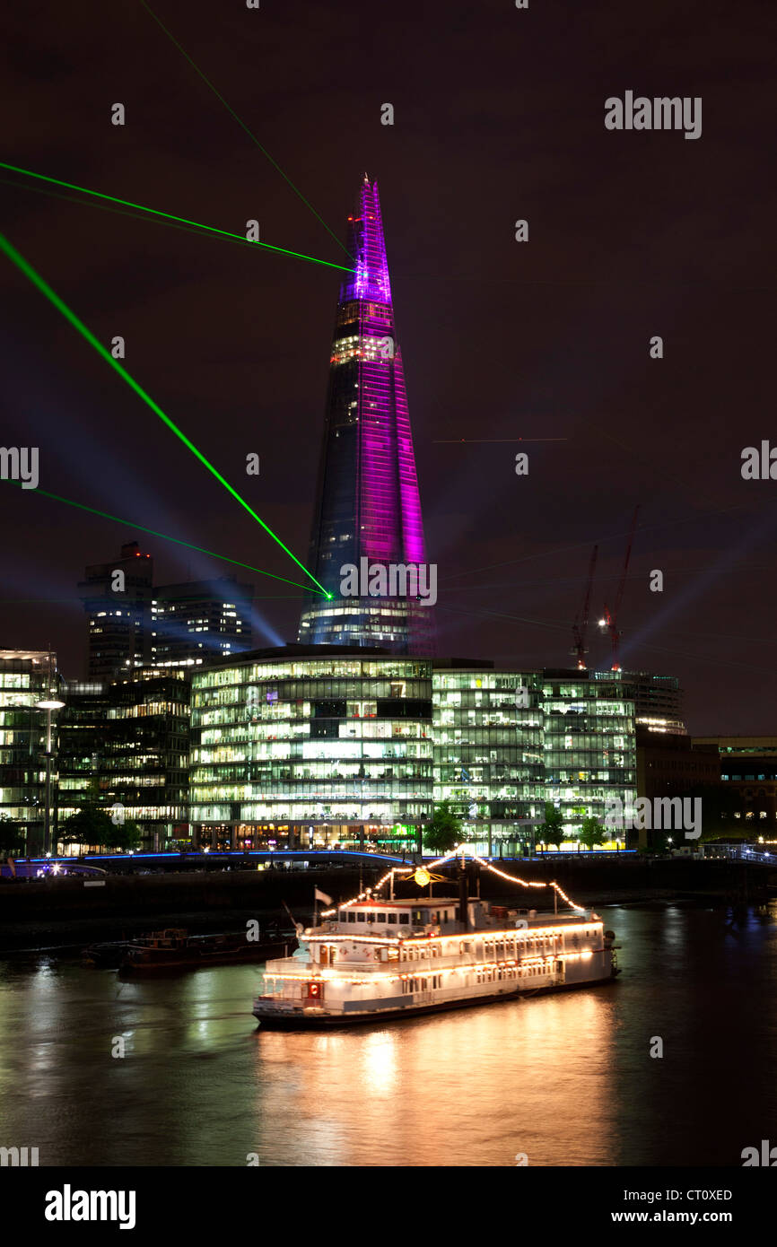 Inauguration laser light show for The Shard. Beaming across the skyline and illuminating the tallest skyscraper - Stock Image