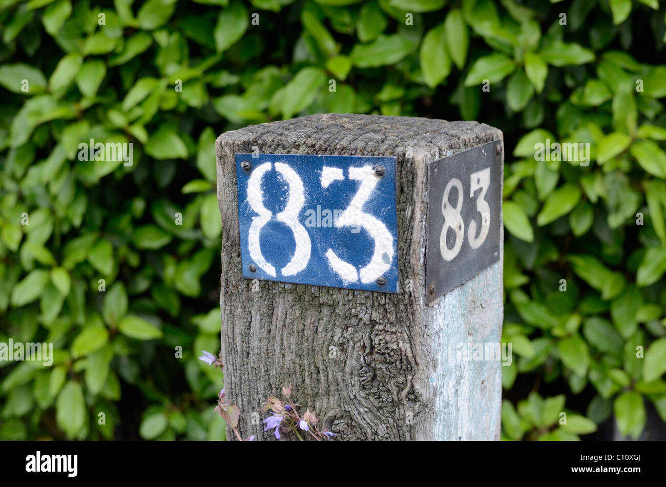 The number 83 on a gatepost - Stock Image