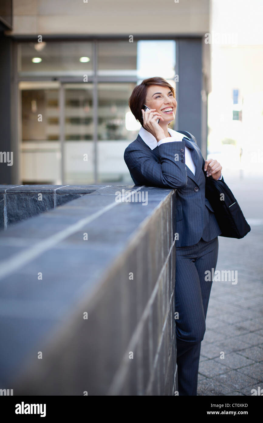 Businesswoman talking on cell phone - Stock Image
