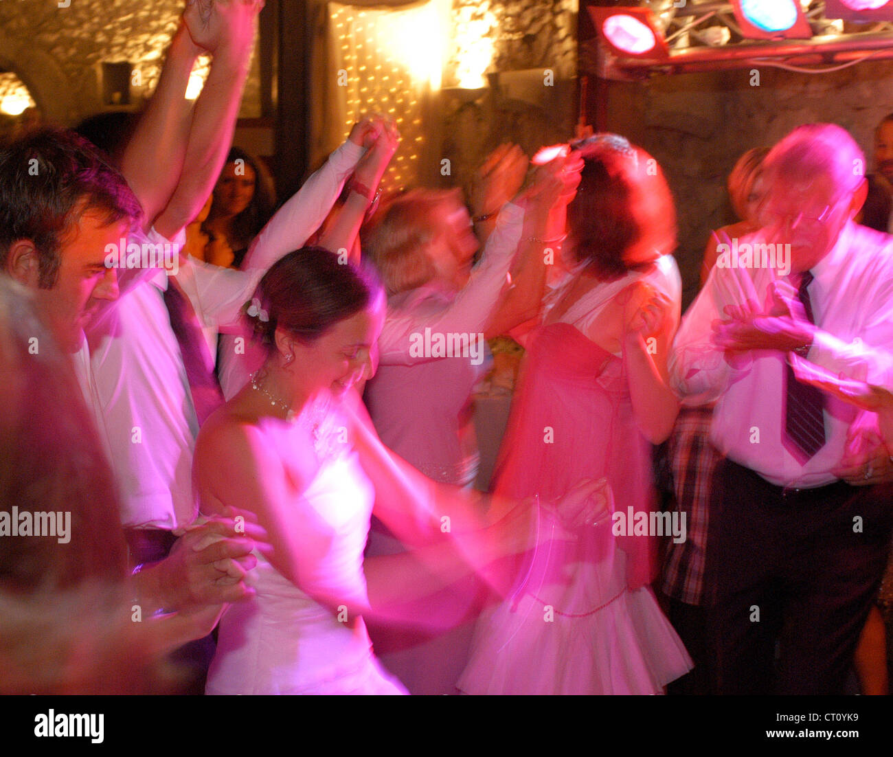 A bride dances with the guests omitted - Stock Image