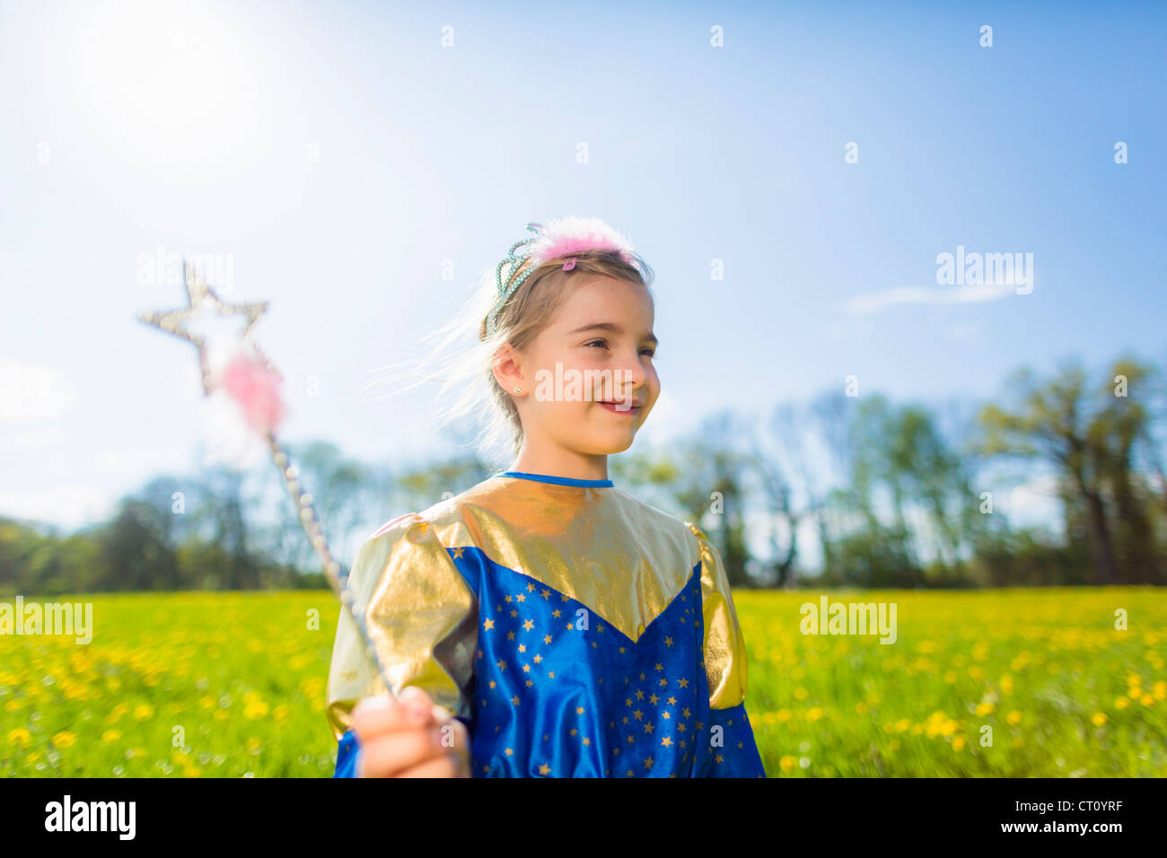 Girl wearing fairy costume outdoors - Stock Image