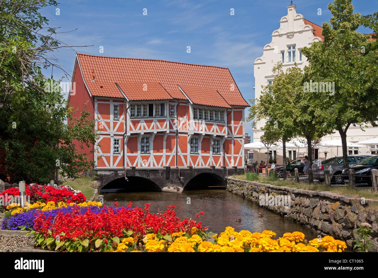 frame house called Gewoelbe built across River Grube, Wismar, Mecklenburg-West Pomerania, Germany - Stock Image