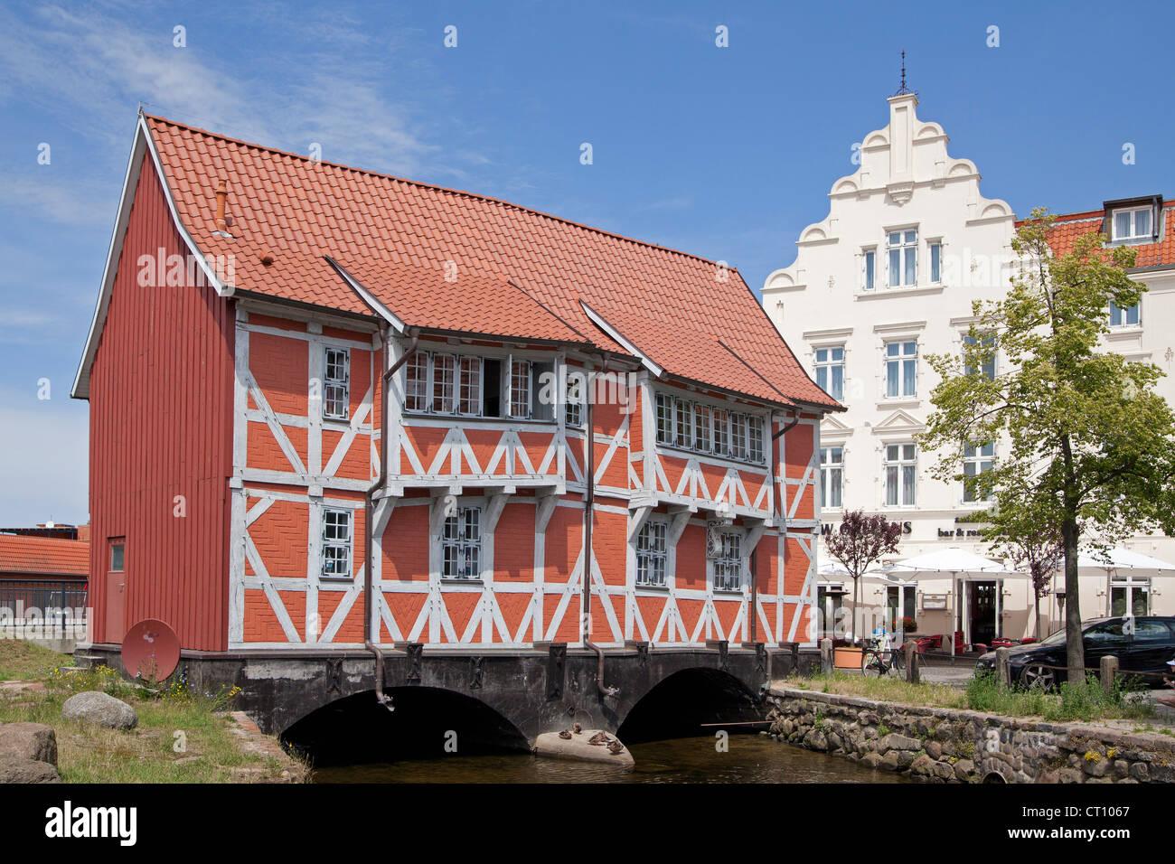 frame house called Gewoelbe built across River Grube, Wismar, Mecklenburg-West Pomerania, Germany Stock Photo