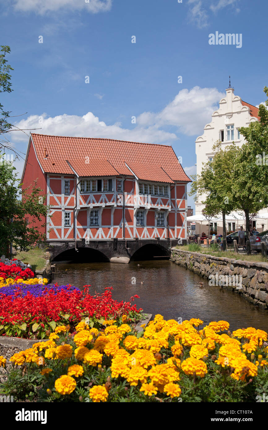 frame house called Gewoelbe built across River Grube, Wismar, Mecklenburg-West Pomerania, Germany - Stock Image