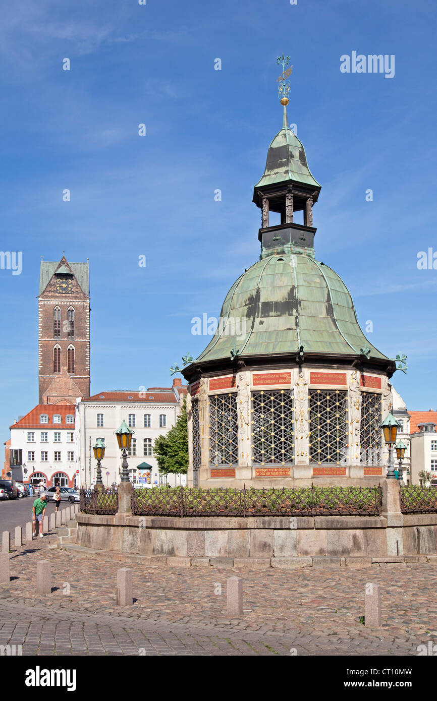 Church Tower of St.Marien and market square with Wasserkunst, Wismar, Mecklenburg-West Pomerania, Germany Stock Photo