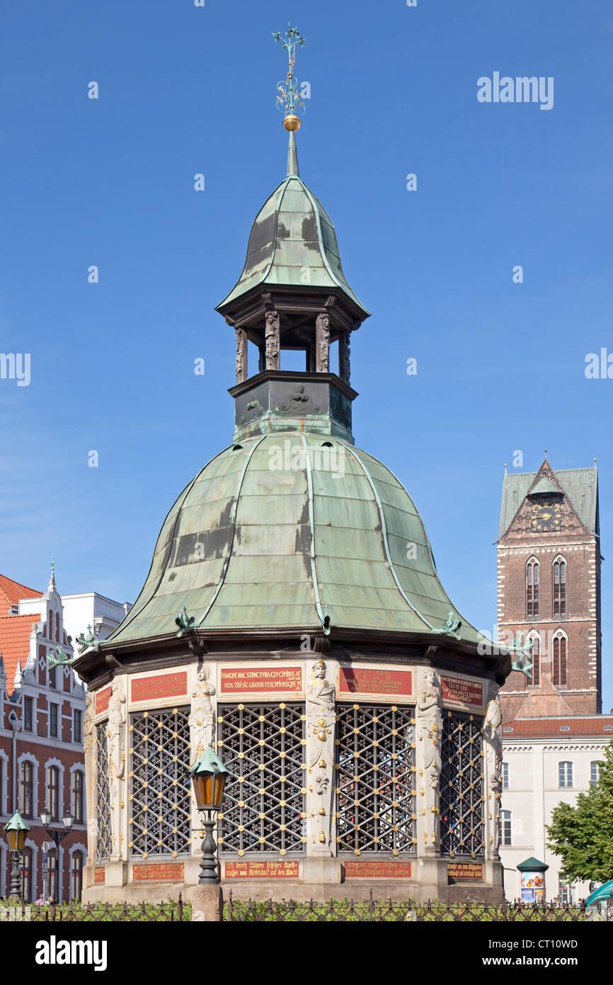 Wasserkunst, and Tower of St. Marien Church, Wismar, Mecklenburg-West Pomerania, Germany - Stock Image