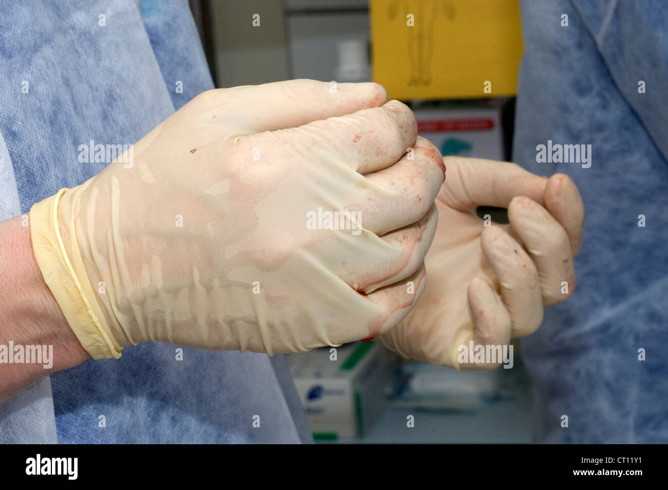 Surgeon's gloved hands. - Stock Image