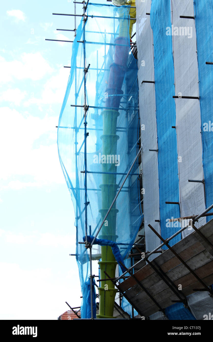 Protection on construction scaffolding with dry debris. - Stock Image