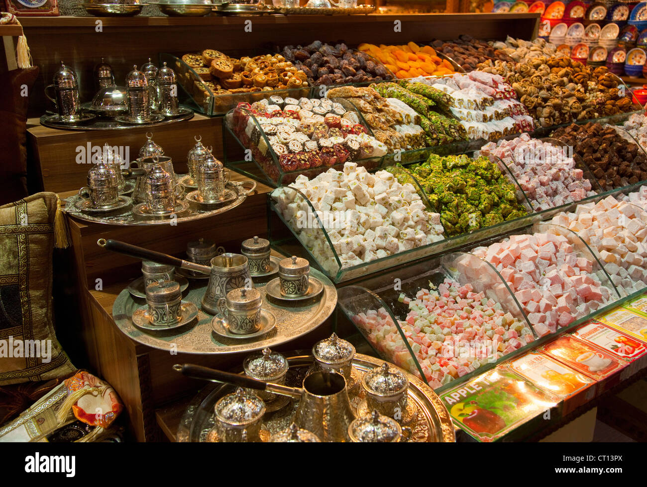 Candies and tea sets for sale - Stock Image