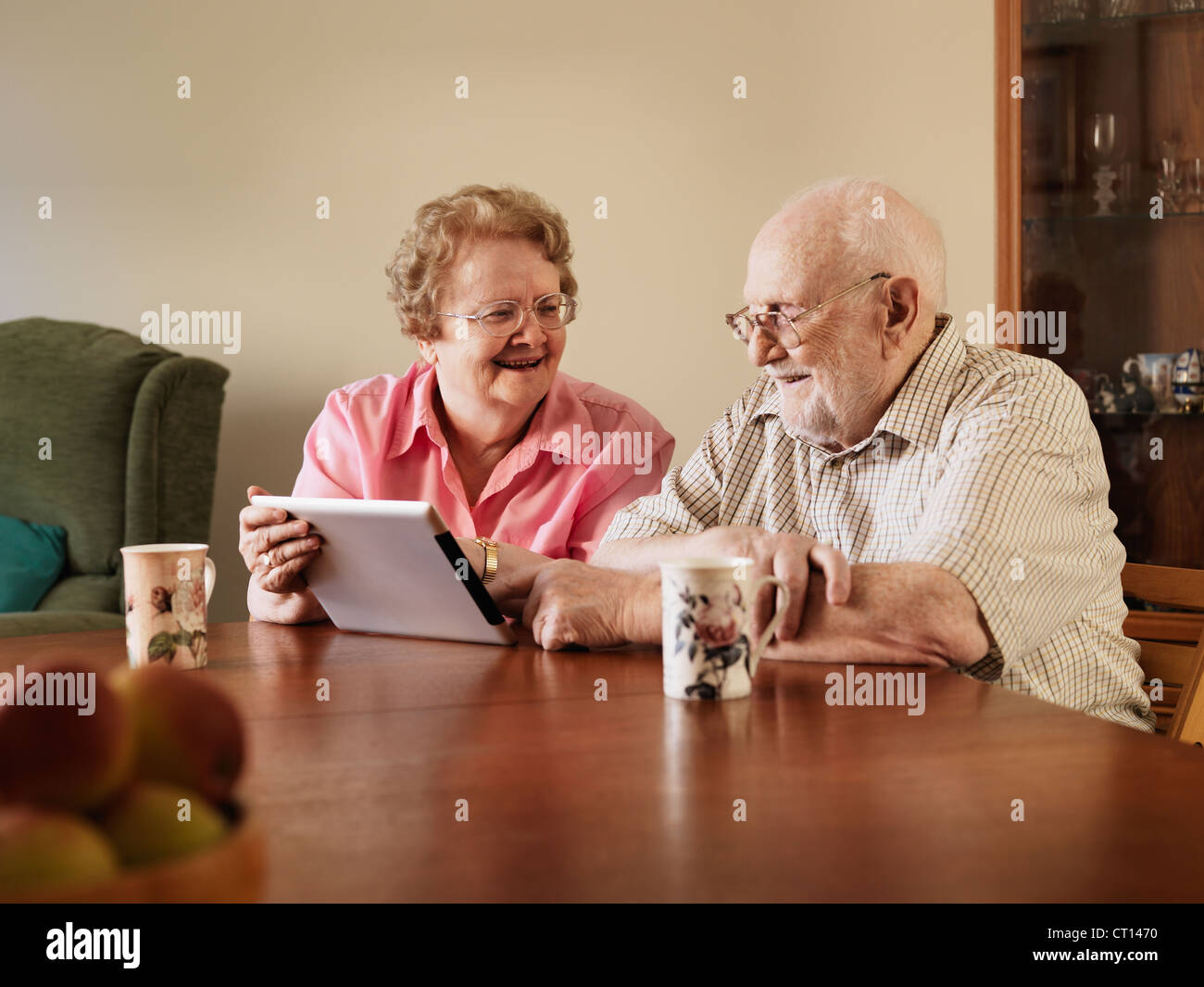 Older couple using tablet computer Stock Photo