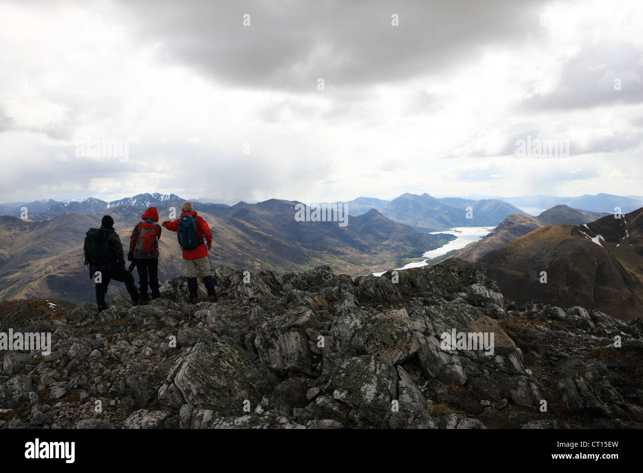Hill walkers looking at the view from the summit of Na Gruagaichean in the Scottish highlands. - Stock Image