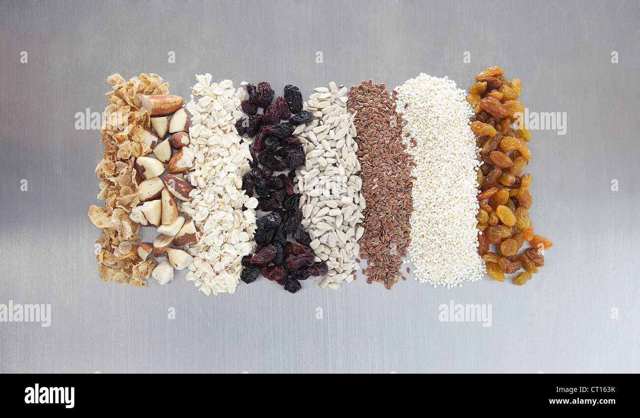 Raw nuts, dried fruit and grains - Stock Image